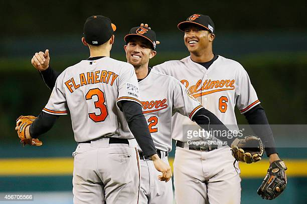 Ryan Flaherty JJ Hardy and Jonathan Schoop of the Baltimore Orioles celebrate their 2 to 1 win over the Detroit Tigers to sweep the series in Game...