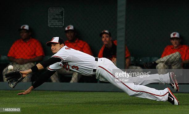 Ryan Flaherty of the Baltimore Orioles catches a ball for an out hit by Alex Presley of the Pittsburgh Pirates during the third inning at Oriole Park...