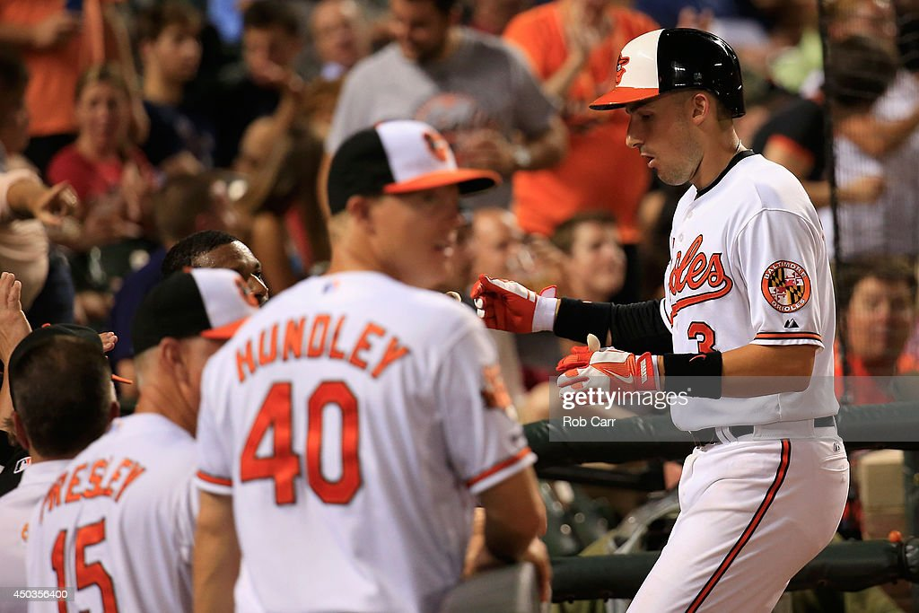 Ryan Flaherty #3 of the Baltimore Orioles celebrates following his solo home run against the Boston Red Sox during the seventh inning of the Orioles 4-0 win at Oriole Park at Camden Yards on June 9, 2014 in Baltimore, Maryland.