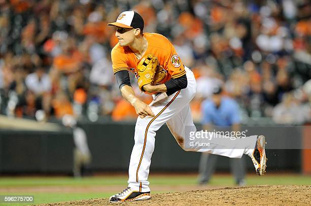 Ryan Flaherty of the Baltimore Orioles pitches in the ninth inning against the Houston Astros at Oriole Park at Camden Yards on August 20 2016 in...