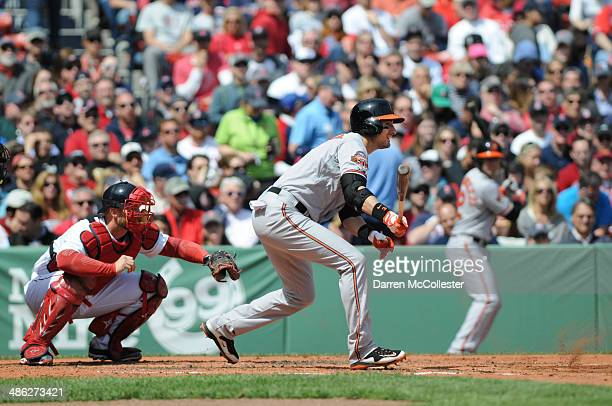 Ryan Flaherty of the Baltimore Orioles swings at a pitch in the third inning against the Boston Red Sox at Fenway Park April 21 2014 in Boston...