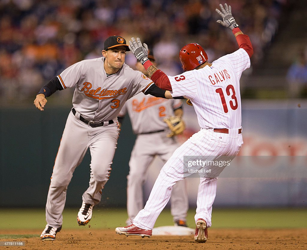 Ryan Flaherty #3 of the Baltimore Orioles tags out Freddy Galvis #13 of the Philadelphia Phillies and turns the game ending double play in the bottom of the ninth inning on June 17, 2015 at the Citizens Bank Park in Philadelphia, Pennsylvania. The Orioles defeated the Phillies 6-4.
