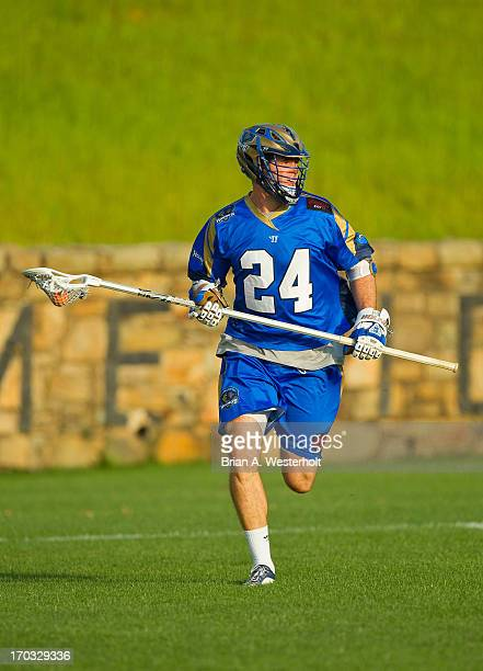 Ryan Flanagan of the Charlotte Hounds carries the ball up the field against the Ohio Machine at American Legion Memorial Stadium on June 8 2013 in...