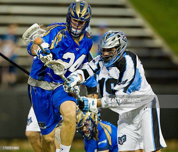 Ryan Flanagan of the Charlotte Hounds keeps the ball away from Joe Cummings of the Ohio Machine during second half action at American Legion Memorial...