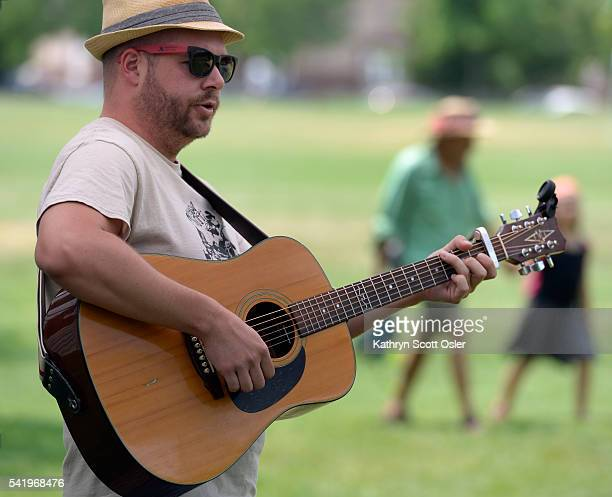 Ryan Flick plays his guitar under the shade of a tree at the park Swallow Hill Music helps to sponsor the annual worldwide Make Music day here in...