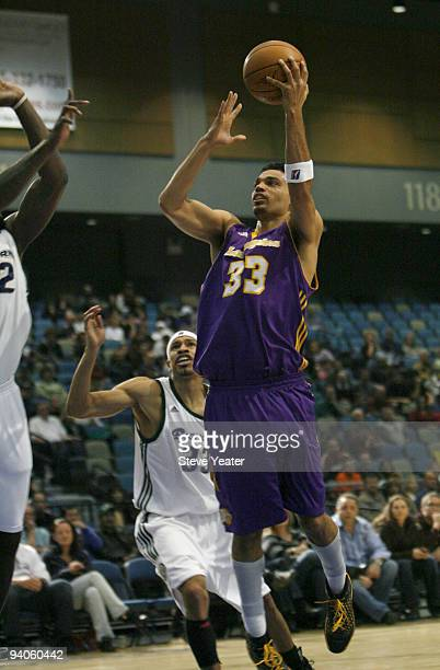 Ryan ForehanKelly right of the Los Angeles DFenders gets around Desmon Farmer left of the Reno Bighorns during an NBA DLeague game at the Reno Events...