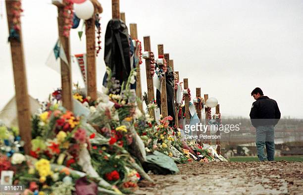 Ryan Foreman of Denver's South Metro Fire Department visits a memorial for the victims of Columbine High School tragedy in Clement Park April 30 1999...