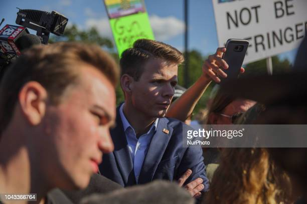 Ryan Fournier Chairman of Students for Trump listens to Kaitlin Bennett debate counter protesters Kaitlin Bennett a former student of Kent State...