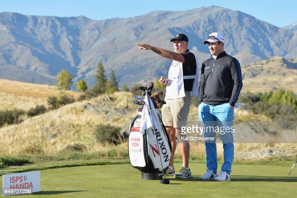 Ryan Fox of New Zealand and his caddie Steve Williams reacting during day one of the New Zealand Open at The Hills on March 9 2017 in Queenstown New...