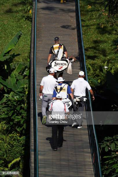 Ryan Fox of New Zealand and Lee Westwood of England walks on the bridge towaards the 5th hole during day four of the Maybank Championship Malaysia at...