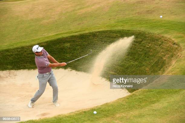 Ryan Fox of New Zealand hits from a bunker on the 14th hole during the final round of the Dubai Duty Free Irish Open at Ballyliffin Golf Club on July...
