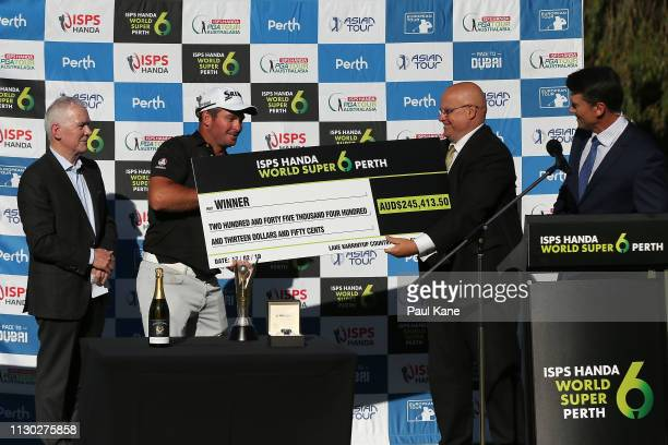 Ryan Fox of New Zealand is presented the winners cheque after defeating Adrian Otaegui Spain in the final during day 4 of the ISPS Handa World Super...
