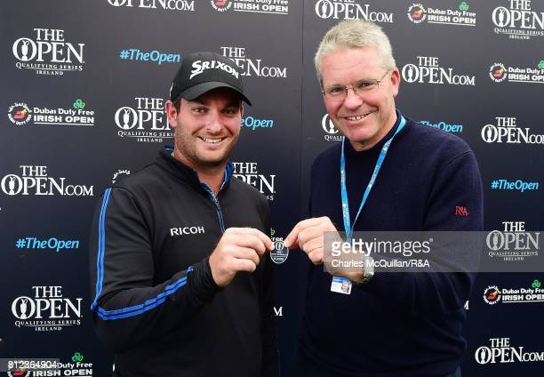 Ryan Fox of New Zealand is presented with his qualifying badge for The Open at Royal Birkdale by Andrew Bathurst of the R A following the final round...