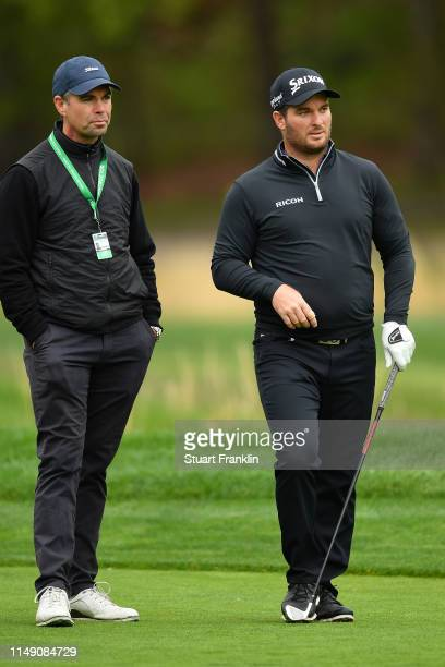 Ryan Fox of New Zealand talks with his coach during a practice round prior to the 2019 PGA Championship at the Bethpage Black course on May 14 2019...