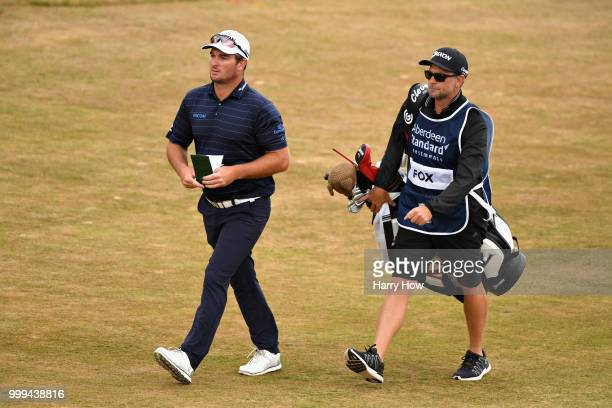 Ryan Fox of New Zealand walks with his caddy on the fairway of hole one during day four of the Aberdeen Standard Investments Scottish Open at Gullane...