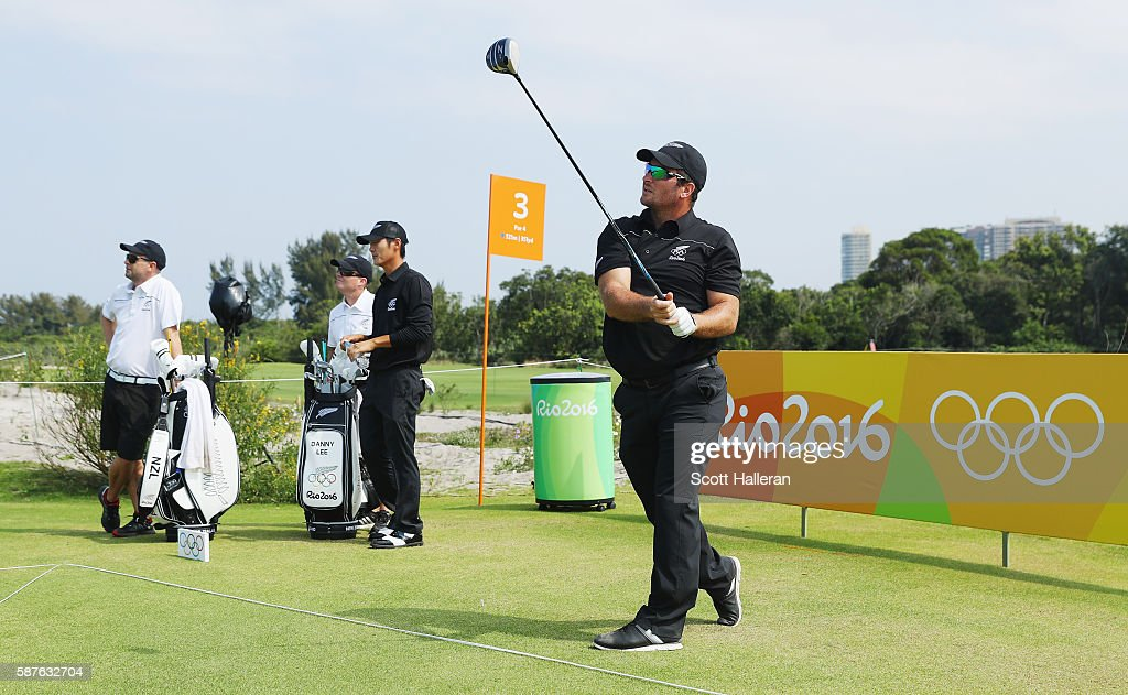 Ryan Fox of New Zealand watches a tee shot as Danny Lee looks on during a practice round on Day 4 of the Rio 2016 Olympic Games at Olympic Golf Course on August 9, 2016 in Rio de Janeiro, Brazil.