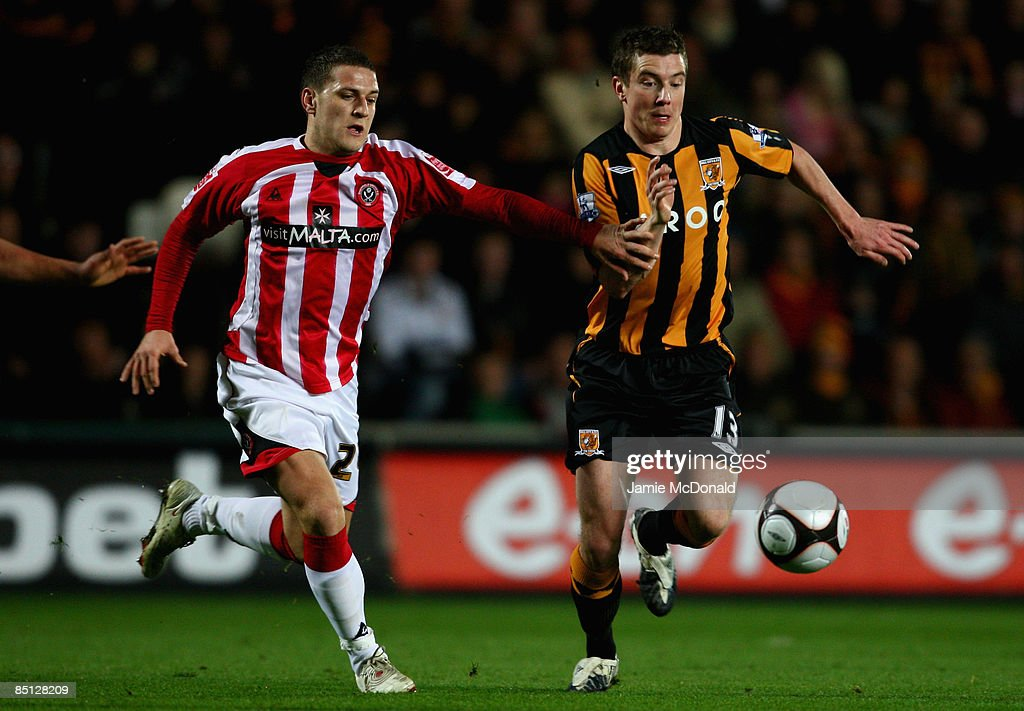 Ryan France of Hull battles with Billy Sharp of Sheffield United during the FA Cup sponsored by E.on, 5th round replay match between Hull City and Sheffield United at the KC Stadium on February 26, 2009 in Hull, England.
