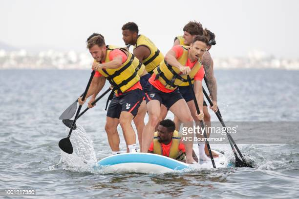 Ryan Fraser and Marc Pugh of Bournemouth lead the way during preseason teambuilding exercise involving paddle boards on July 18 2018 in La Manga Spain