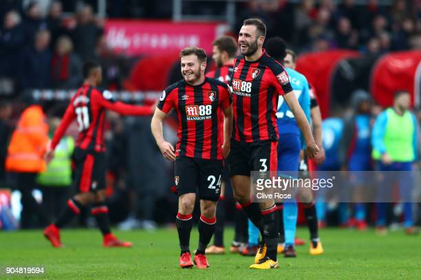 Ryan Fraser and Steve Cook of AFC Bournemouth celebrate after the Premier League match between AFC Bournemouth and Arsenal at Vitality Stadium on...