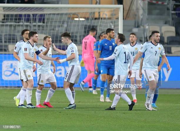 Ryan Fraser celebrates after scoring his team's first goal with teammates during the FIFA World Cup 2022 Qatar qualifying match between Israel and...