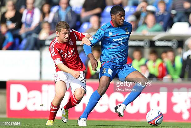 Ryan Fraser of Aberdeen competes with Andre Blackman of Inverness Caledonian Thistle during the Clydesdale Bank Scottish Premier League match on...