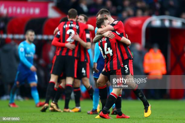 Ryan Fraser of AFC Bournemouth and Steve Cook of AFC Bournemouth celebrate the victory after the Premier League match between AFC Bournemouth and...