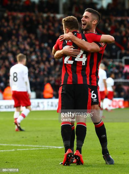 Ryan Fraser of AFC Bournemouth celebrates after scoring his sides first goal with Andrew Surman of AFC Bournemouth during the Premier League match...