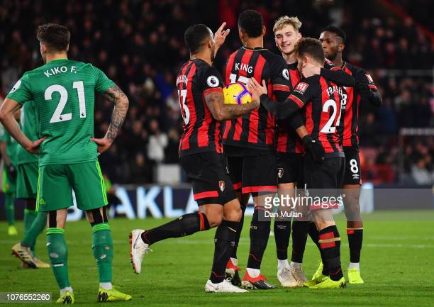 Ryan Fraser of AFC Bournemouth celebrates scores his team's third goal with team mates during the Premier League match between AFC Bournemouth and...