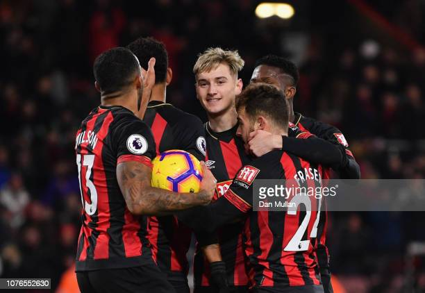 Ryan Fraser of AFC Bournemouth celebrates scores his team's third goal with David Brooks and team mates during the Premier League match between AFC...
