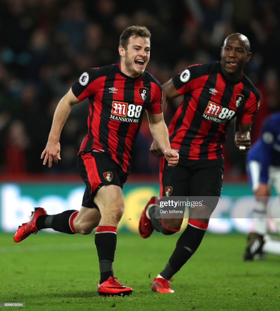 Ryan Fraser (L) of AFC Bournemouth celebrates scoring his team's second goal with Benik Afobe of AFC Bournemouth during the Premier League match between AFC Bournemouth and Everton at Vitality Stadium on December 30, 2017 in Bournemouth, England.