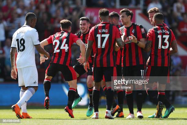 Ryan Fraser of AFC Bournemouth celebrates with Lewis Cook of AFC Bournemaouth nd teammates after he scores his sides first goal during the Premier...