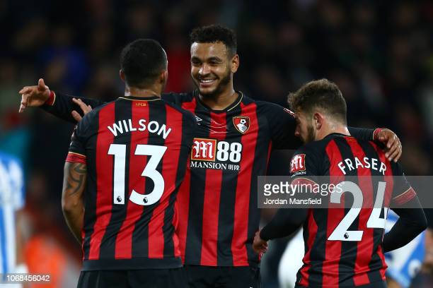 Ryan Fraser of AFC Bournemouth celebrates with teammates after scoring his team's second goal during the Premier League match between AFC Bournemouth...
