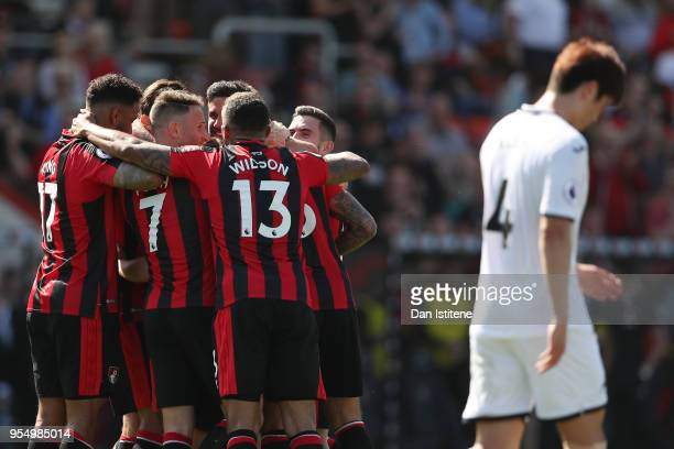 Ryan Fraser of AFC Bournemouth celebrates with teammates as Ki SungYueng of Swansea City looks on dejected after he scores his sides first goal...