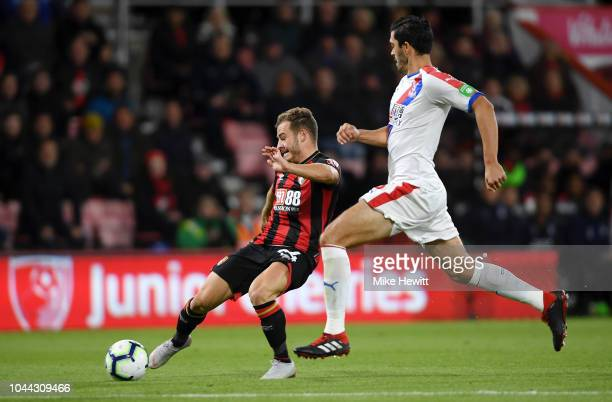 Ryan Fraser of AFC Bournemouth controls the ball as James Tomkins of Crystal Palace looks on during the Premier League match between AFC Bournemouth...