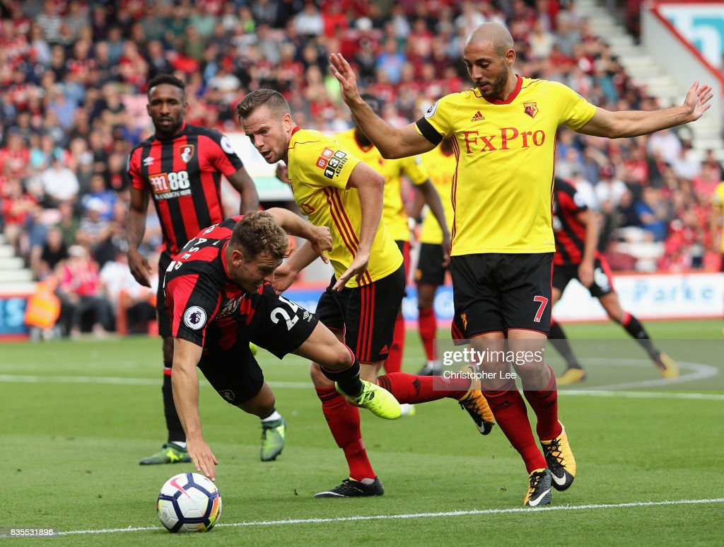Ryan Fraser of AFC Bournemouth goes down in the penalty area after he was challeneged by Nordin Amrabat of Watford during the Premier League match between AFC Bournemouth and Watford at Vitality Stadium on August 19, 2017 in Bournemouth, England.
