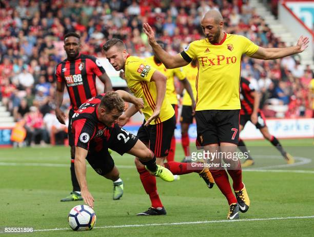 Ryan Fraser of AFC Bournemouth goes down in the penalty area after he was challeneged by Nordin Amrabat of Watford during the Premier League match...