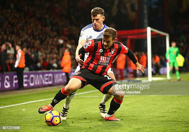 Ryan Fraser of AFC Bournemouth is put under pressure from Billy Jones of Sunderland during the Premier League match between AFC Bournemouth and...