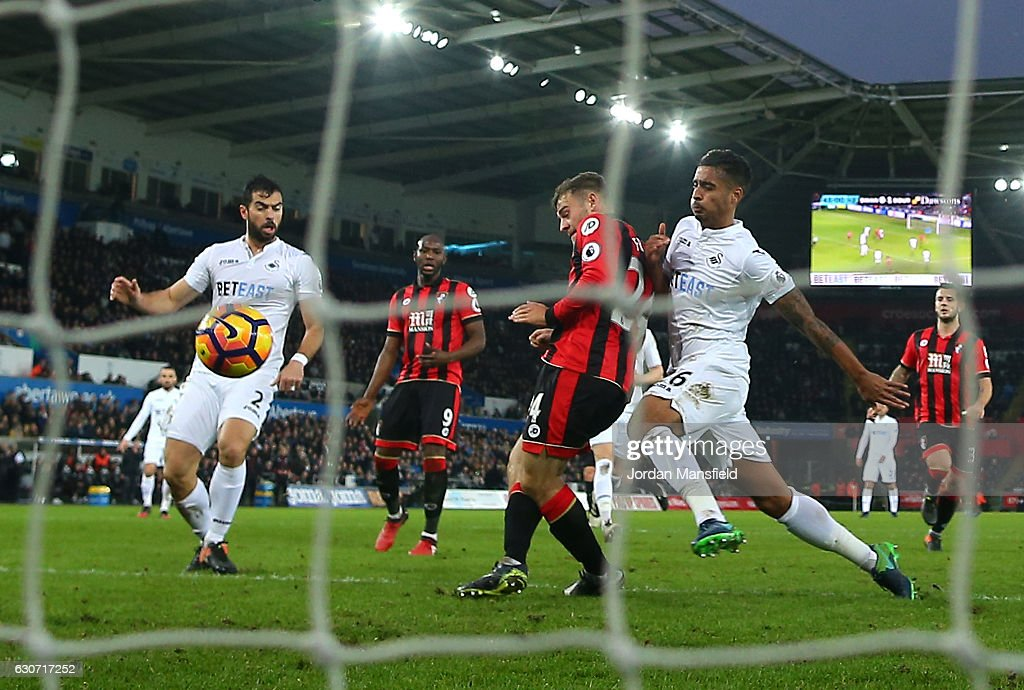Ryan Fraser (C) of AFC Bournemouth scores his side's second goal during the Premier League match between Swansea City and AFC Bournemouth at Liberty Stadium on December 31, 2016 in Swansea, Wales.