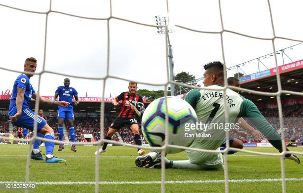 Ryan Fraser of AFC Bournemouth scores his team's first goal past Neil Etheridge of Cardiff City during the Premier League match between AFC...