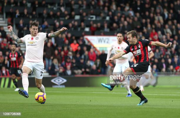 Ryan Fraser of AFC Bournemouth shoots as Victor Lindelof of Manchester United attempts to block during the Premier League match between AFC...