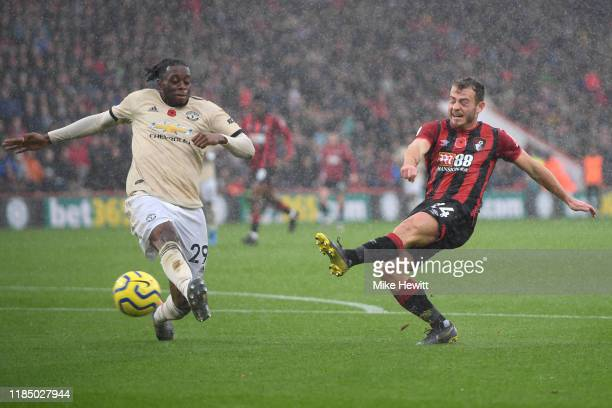 Ryan Fraser of AFC Bournemouth shoots wide as he is closed down by Aaron WanBissaka of Manchester United during the Premier League match between AFC...