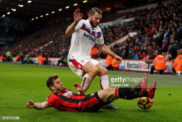 Ryan Fraser of AFC Bournemouth tackles Erik Pieters of Stoke City during the Premier League match between AFC Bournemouth and Stoke City at Vitality...