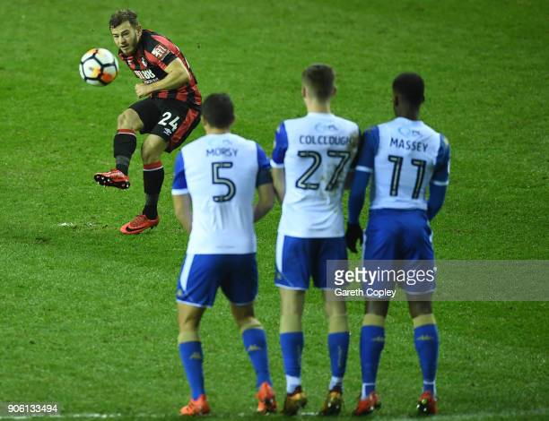 Ryan Fraser of AFC Bournemouth takes a freekick during The Emirates FA Cup Third Round Replay between Wigan and AFC Bournemouth at DW Stadium on...
