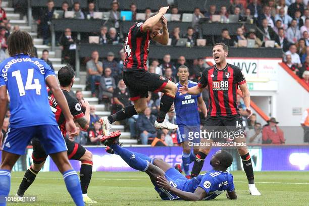 Ryan Fraser of Bournemouth holds his head after being hit by the foot of Sol Bamba of Cardiff as he attempted an overhead kick during the Premier...