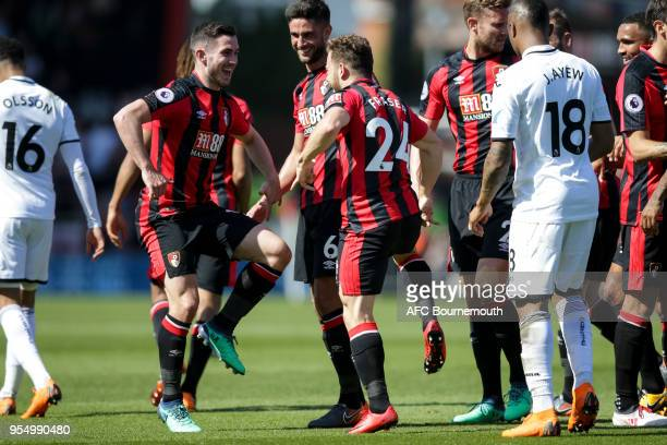 Ryan Fraser of Bournemouth scores a goal to make it 10 and celebrates with Lewis Cook of Bournemouth during the Premier League match between AFC...