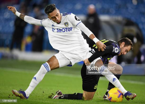 Ryan Fraser of Newcastle United and Raphinha of Leeds United battle for the ball during the Premier League match between Leeds United and Newcastle...