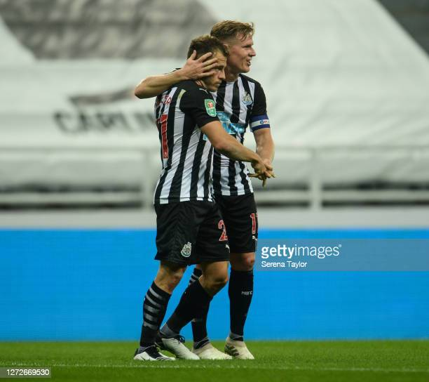 Ryan Fraser of Newcastle United celebrates with teammate Matt Ritchie after scoring the opening goal on his debut during the Carabao Cup Second Round...