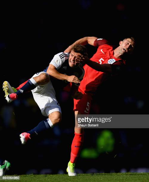 Ryan Fraser of Scotland and Gary Cahill of England battle for possession during the FIFA 2018 World Cup Qualifier between Scotland and England at...