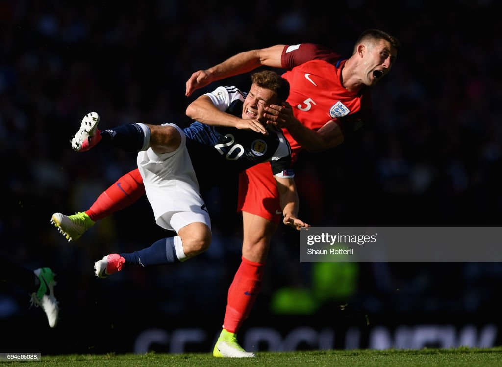 Ryan Fraser of Scotland and Gary Cahill of England battle for possession during the FIFA 2018 World Cup Qualifier between Scotland and England at Hampden Park National Stadium on June 10, 2017 in Glasgow, Scotland.