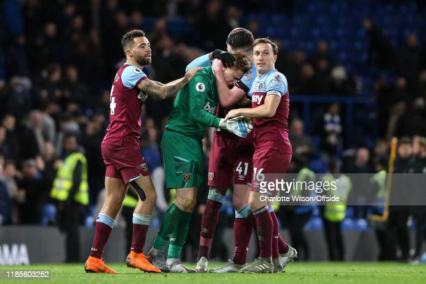 Ryan Fredericks, Angelo Ogbonna, Declan Rice and captain Mark Noble celebrate their 1-0 victory with an emotional West Ham goalkeeper David Martin...